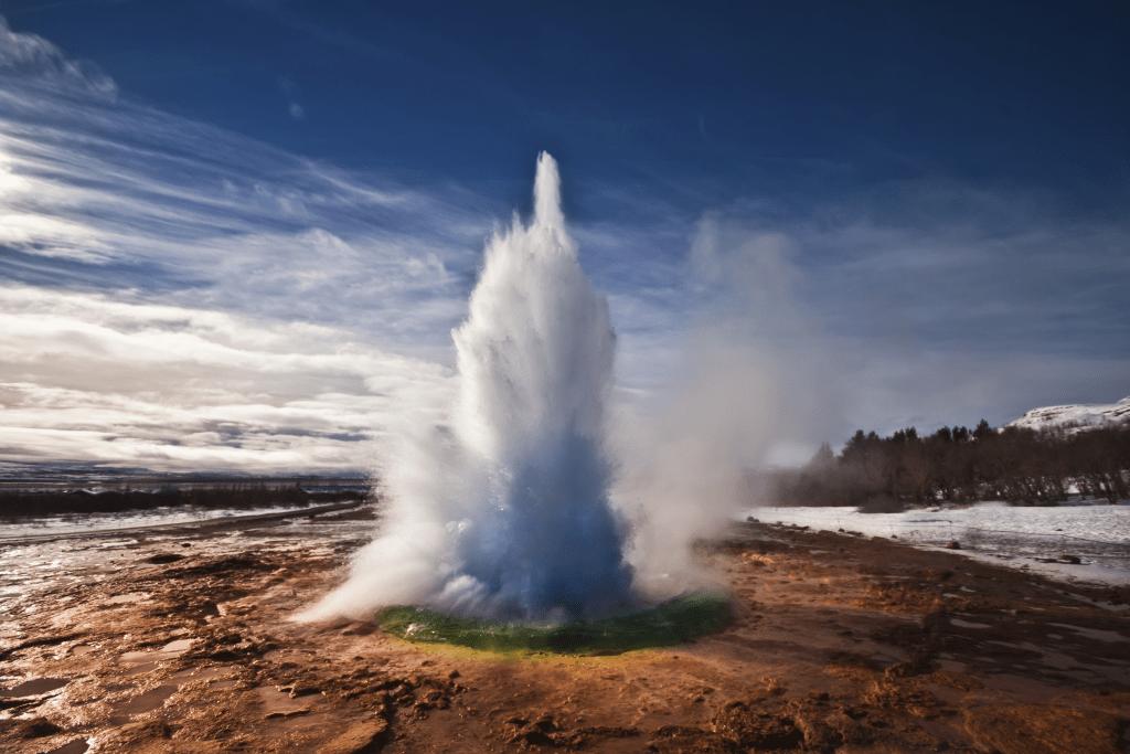 Erupting Strokkur Geyser on a sunny day in Iceland