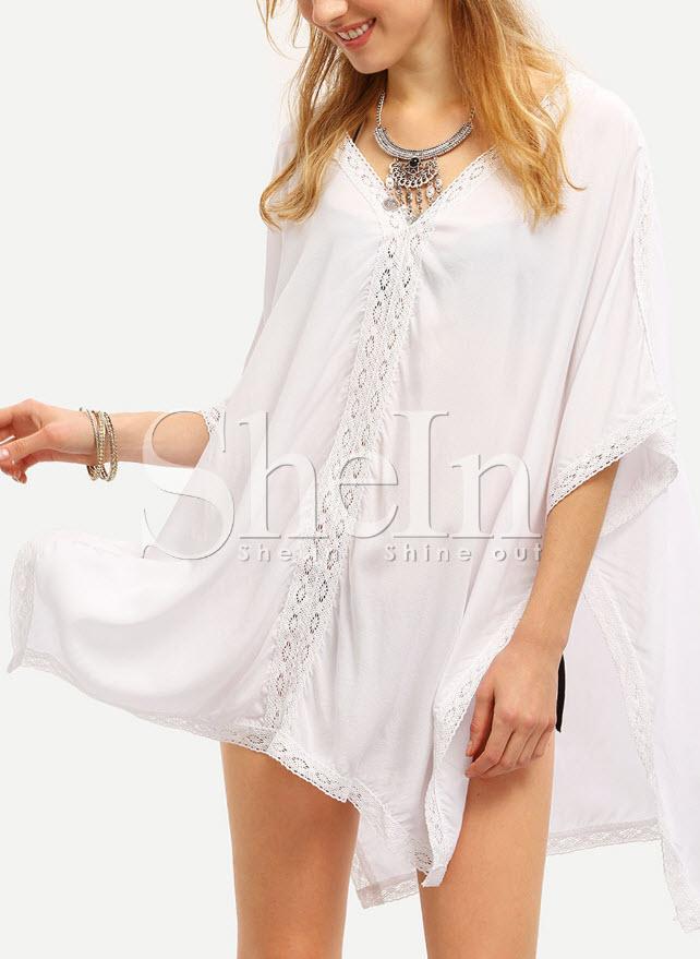 bluza alba lunga larga cu insertii de dantela din macrame cu decolteu in v