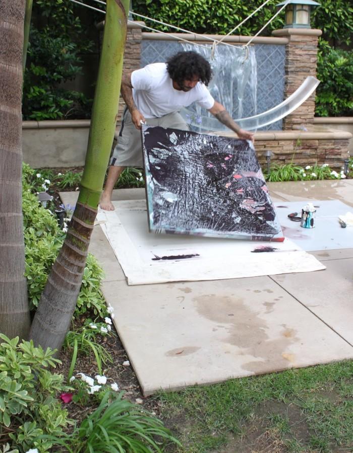 Aaron R. Thomas painting in his studio