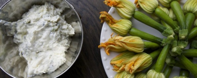 Add some finely chopped, fresh Hatch chiles (or canned green chile) to this signature Ricotta, Pecorino Romano and goat cheese squash blossom stuffing