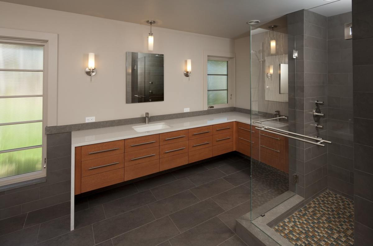corner counter top bathroom with large glass shower enclosure