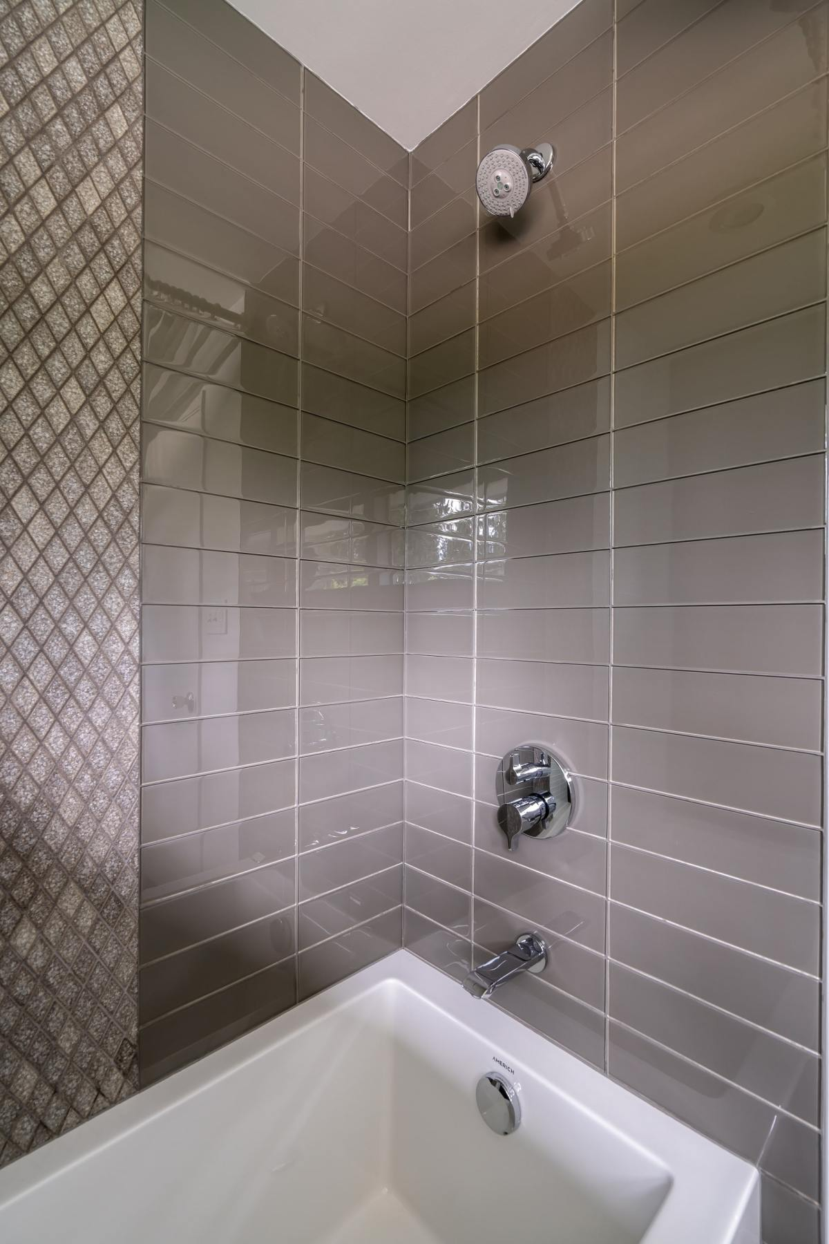 grey rectablge tile in bath tub shower