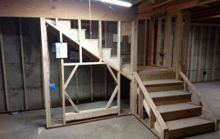 Wood Framing of stairway coming down with a hexagon hole for a tunnel