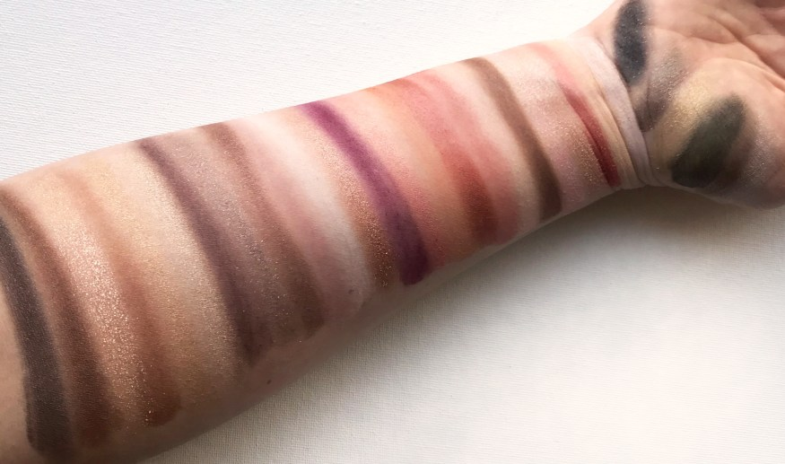 Swatches of all Maybelline Citi Mini palette eyeshadows on one arm
