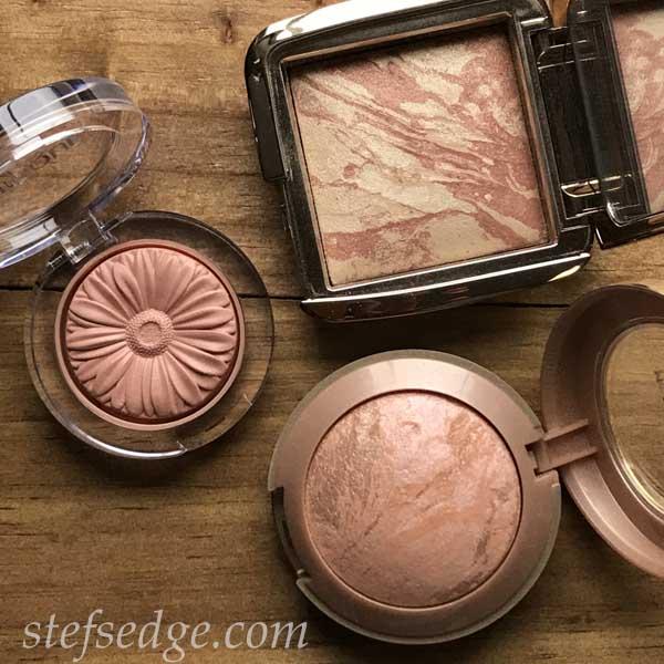 Flatlay of Clinique Nude Pop blush, Hourglass Brilliant Nude Blush, and Milani Rosa Romantica Blush