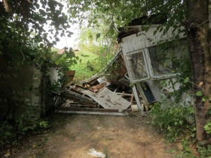 Sheds collapsing into driveway during demolition