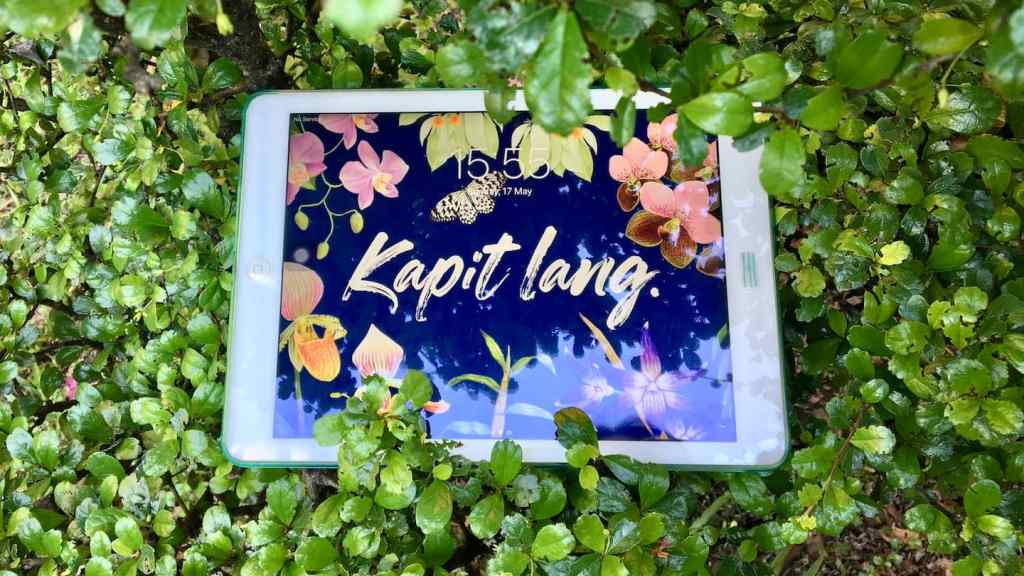 iPad on leaves with Kapit Lang wallpaper