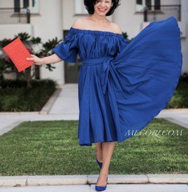 Washed blue cotton dress with MeDusa red slim clutch