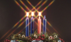 advent candles! three lit candles represent the advent season with joy.