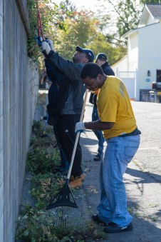 160924-N-XX566-163 BREMERTON, Washington (Sept. 24, 2016) Sailors assigned to USS John C. Stennis (CVN 74) trim overgrown plants from a wall during a community service event. John C. Stennis is conducting a routine maintenance availability following a deployment to U.S. 7th and 3rd fleet areas of operation. (U.S. Navy photo by Mass Communication Specialist 3rd Class Andre T. Richard/ Released)