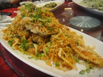 crab with fried fish on top
