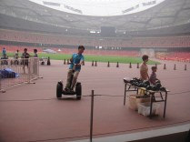 Guys riding Segways all around the Olympic track lol