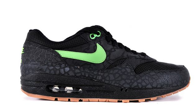 nike original black sneakers with green logo