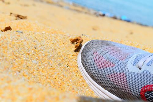 sneaker toe on sand