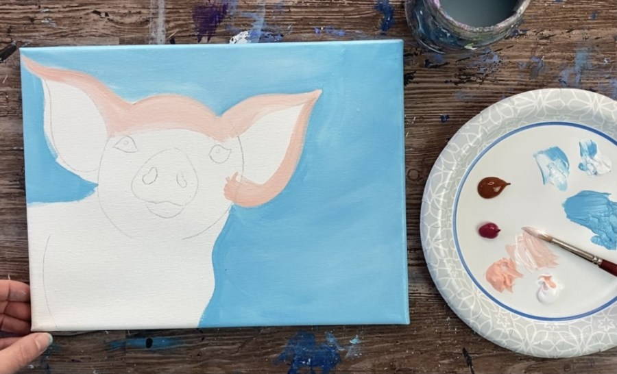 Paint the ears of the pig painting.