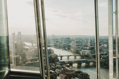 a morning view looking out from the shard at the river thames. a photograph by stephanie green weddings