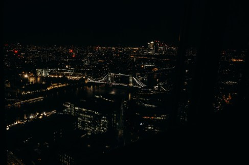 a view of london bridge at night. photo taken by stephanie green from up above from the shangri-la-hotel room, a london lifestyle photographer