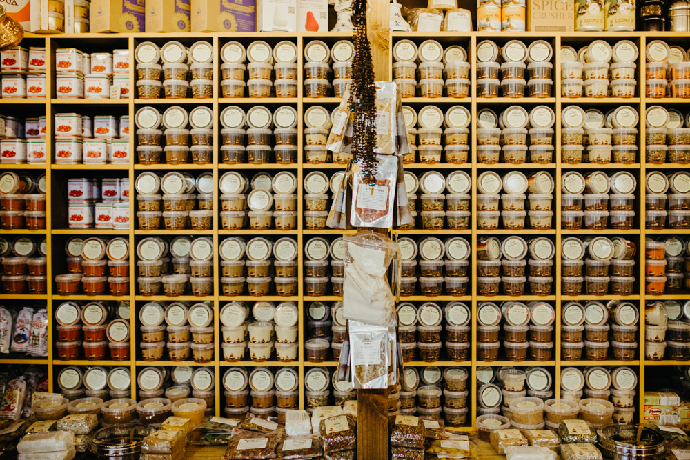 Shelves containing spices at a food stall called Spice Mountain. Picture by Stephanie Green Weddings