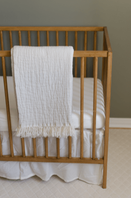nursery-decor-cream-crinkle-throw-sage-feature-wall-stained-ikea-crib-sniglar-3381