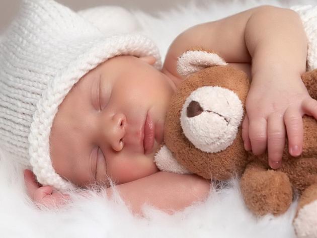 sleeping-baby-with-animal
