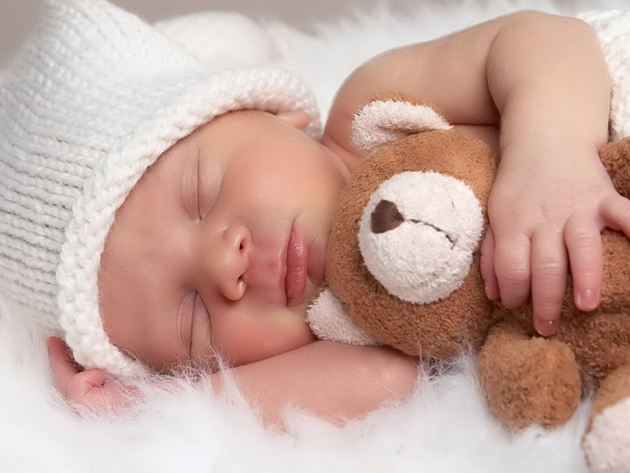 sleeping-baby-with-animal