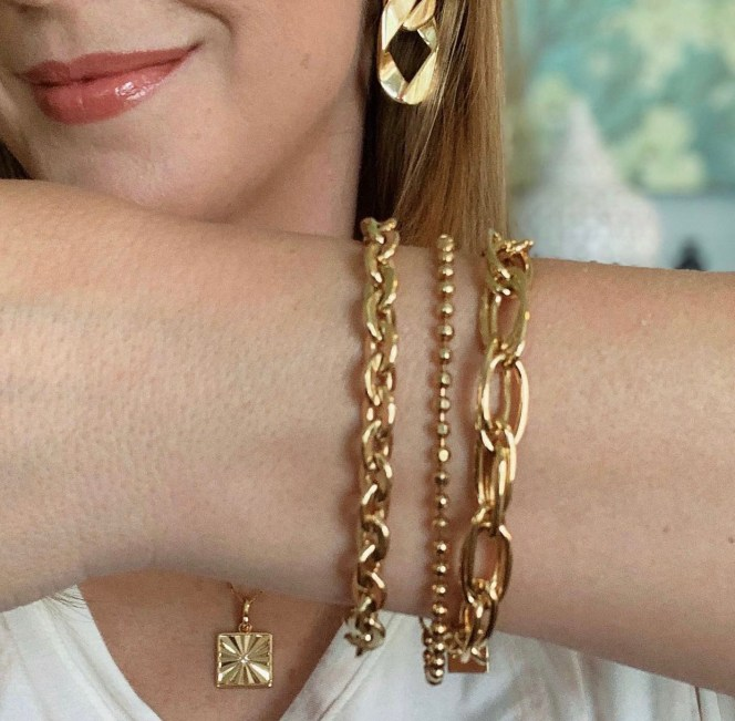 gold bracelets on wrist