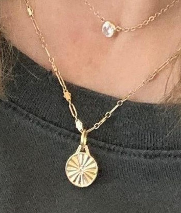 gold necklace on black shirt