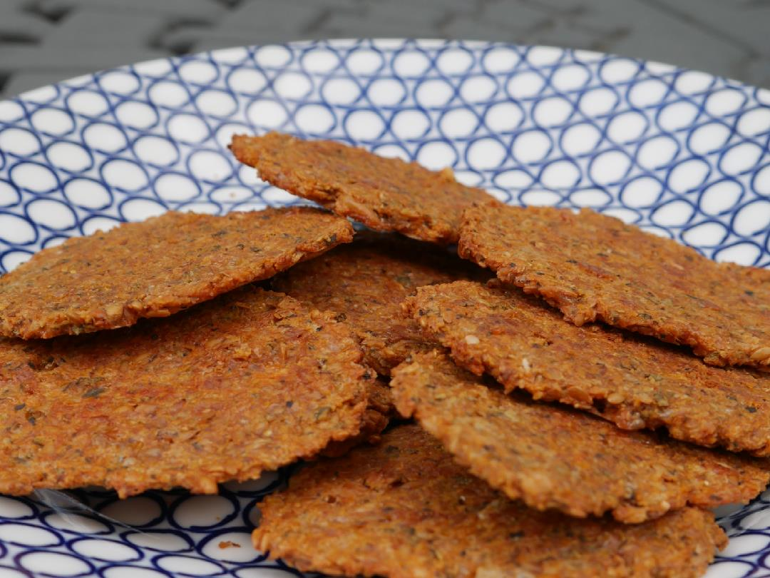 Flaxseed crackers on plate with blue pattern
