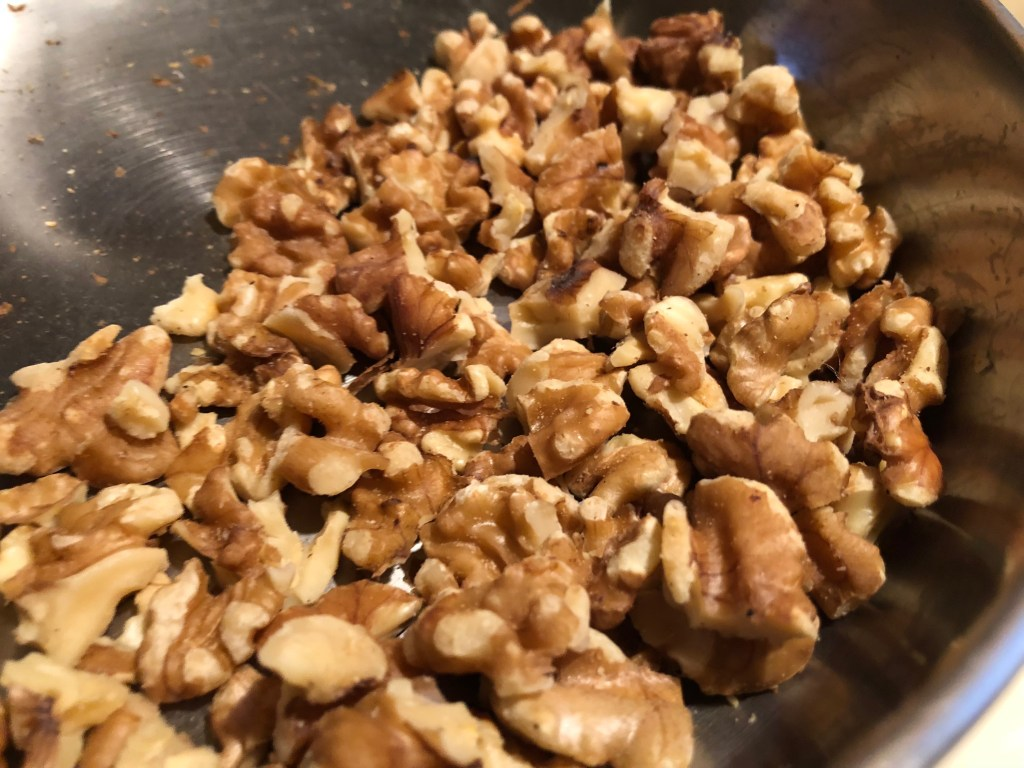 Walnut halves in a pan