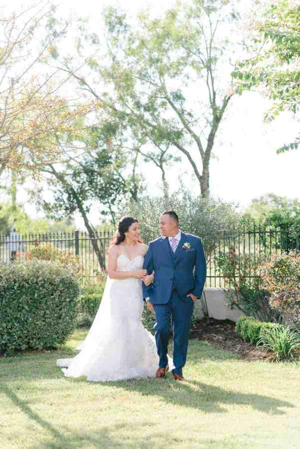 Bride and groom walking Thistlewood manor & gardens wedding