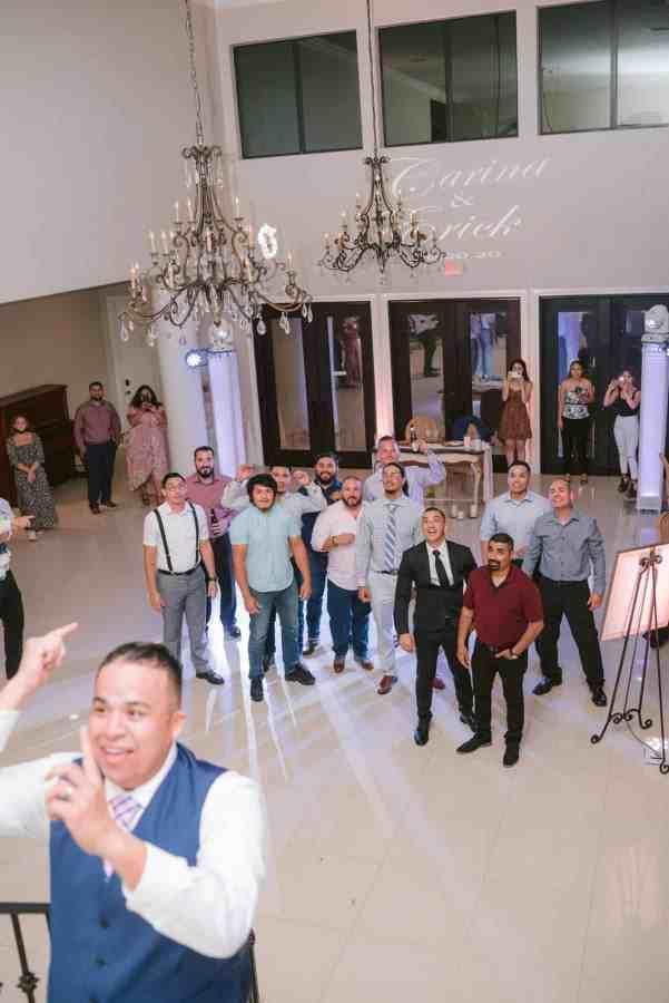Garter toss Thistlewood manor & gardens wedding