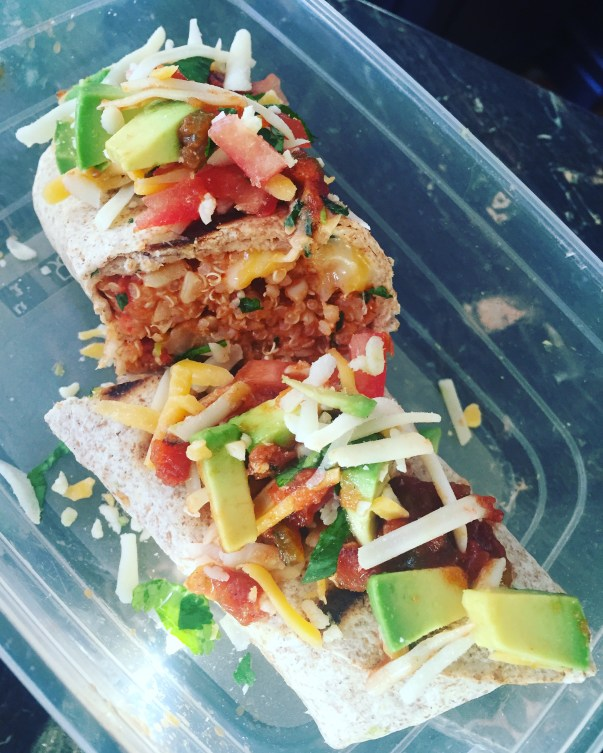 Lunch box burrito topped with salsa, avocado and more cheese :)