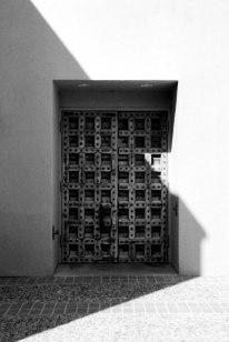 dramatic geometric shadow of icon door