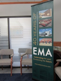 EMA vertical 6 ft banner stand in conference room