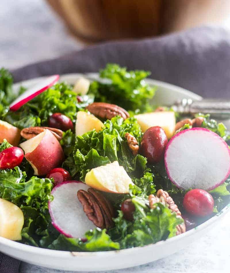 Apple Kale Cranberry Salad in a bowl.