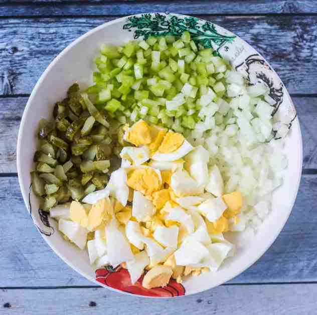 Diced celery, onion, dill pickles and chopped hard boiled eggs.