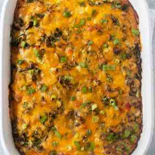 Tater Tot Breakfast Casserole in white casserole pan.