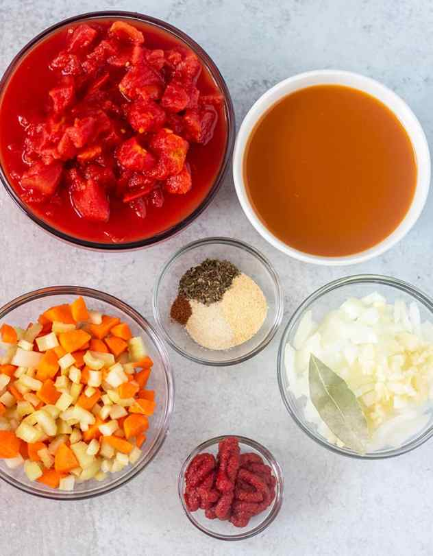 diced tomatoes, vegetable broth, carrots, celery, onion, garlic, tomato paste, seasonings.
