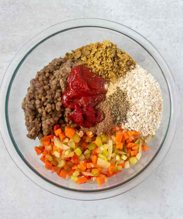 lentils, cooked veggies, oats, cracker crumbs, ketchup, tomato patste and seasonings in a mixing bowl.
