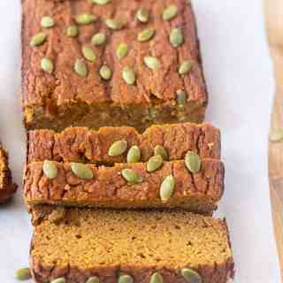 paleo pumpkin bread slice on parchment paper