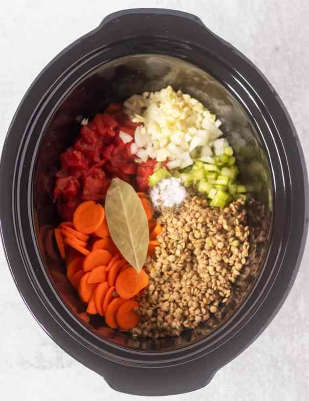 slow cooker lentil soup ingredients in the crock pot.