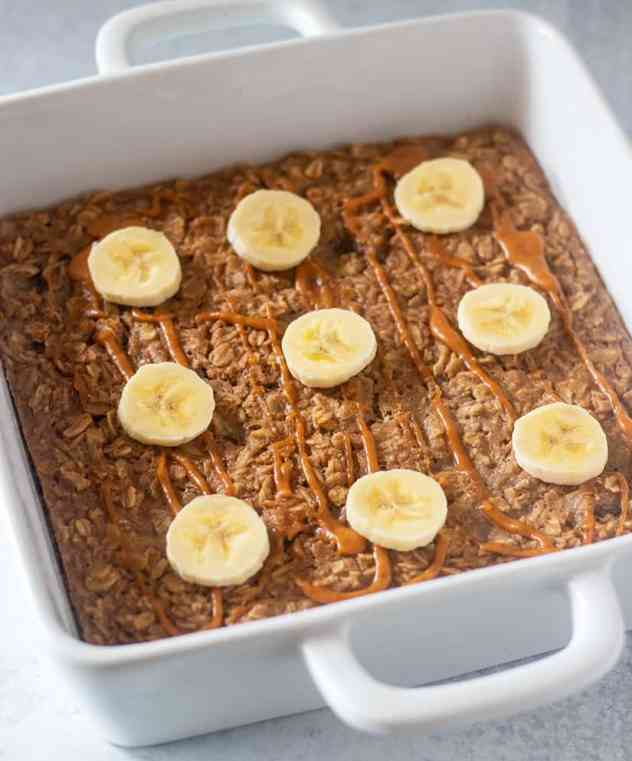 peanut butter banana baked oatmeal drizzled with extra peanut butter and topped with banana slices.