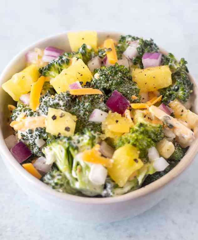 broccoli pineapple salad in a white bowl