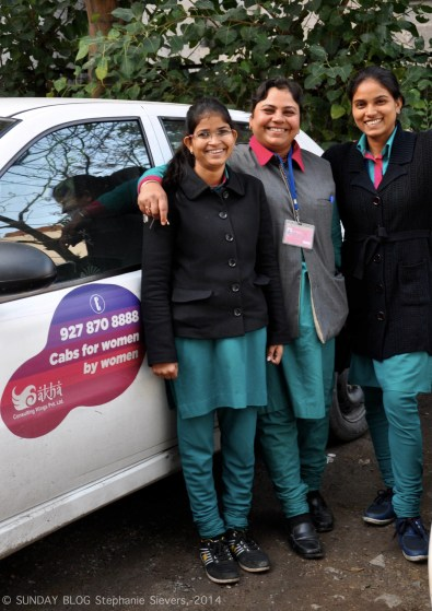 Jyothi & colleagues in front of a Sakha Cab