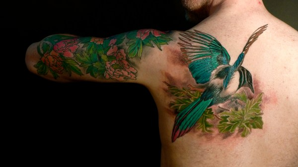 birds and flowers tattoo tattooing