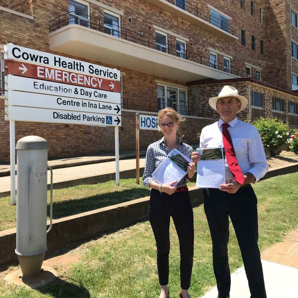 Steph Cooke MP and Mayor Bill West stand outside Cowra Hospital with the petition for an upgrade.