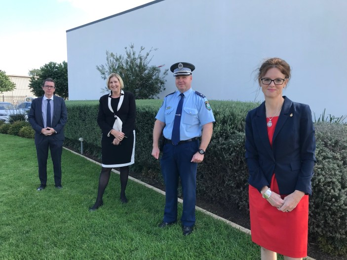 Dr Joe McGirr, Jill Ludford, Bob Noble and Steph Cooke stand distanced from each other in front of a green hedge.