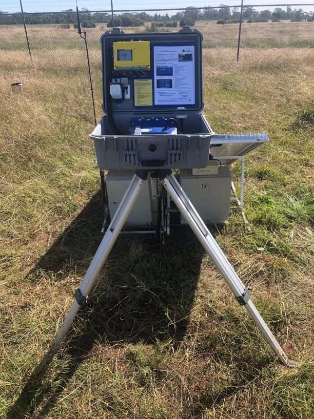 The dust monitoring station sits open in a grassy paddock.