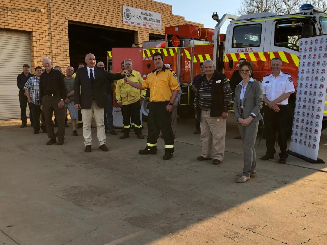 Minister Elliott, Steph Cooke MP and members of the Ganmain RFS Brigade stand in front of the new tanker.