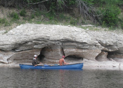 Brian and Nate paddle by the Gypsum Caves